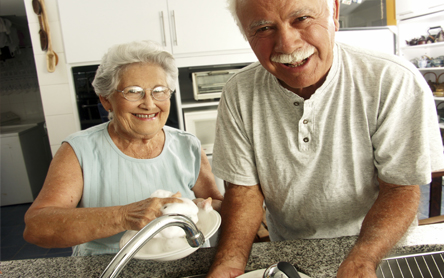 elderly couple doing the dishes by hand
